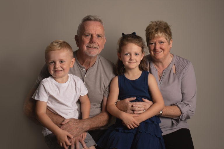 Grandparents in photo with grandkids. Family photographer Strood Medway