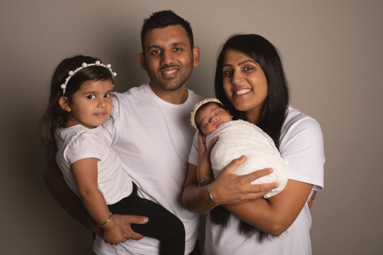 Family photos Strood Medway Kent. Family wearing white and cream tops on cream background.