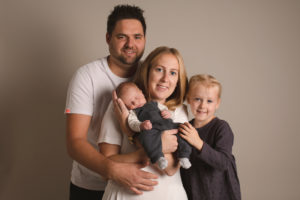 Family newborn photo taken in Medway Kent. Family including mum, dad, sister and newborn baby.