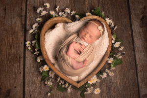 Heart shape with newborn baby wrapped up for photoshoot Medway Kent